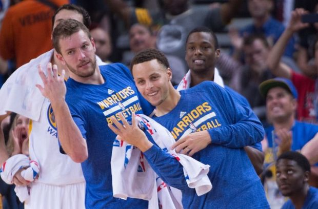 April 2, 2015; Oakland, CA, USA; Golden State Warriors forward David Lee (10, left) and guard Stephen Curry (30, right) celebrate during the third quarter against the Phoenix Suns at Oracle Arena. The Warriors defeated the Suns 107-106. Mandatory Credit: Kyle Terada-USA TODAY Sports