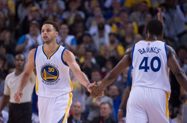 April 9, 2015; Oakland, CA, USA; Golden State Warriors guard Stephen Curry (30) celebrates with forward Harrison Barnes (40) against the Portland Trail Blazers during the first quarter at Oracle Arena. Mandatory Credit: Kyle Terada-USA TODAY Sports