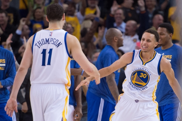 April 2, 2015; Oakland, CA, USA; Golden State Warriors guard Stephen Curry (30) celebrates with guard Klay Thompson (11) during the fourth quarter against the Phoenix Suns at Oracle Arena. The Warriors defeated the Suns 107-106. Mandatory Credit: Kyle Terada-USA TODAY Sports
