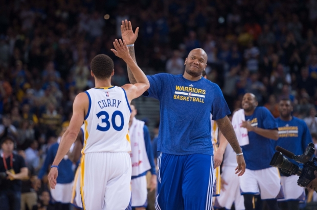 March 23, 2015; Oakland, CA, USA; Golden State Warriors center Marreese Speights (5, right) high-fives guard Stephen Curry (30) during the third quarter against the Washington Wizards at Oracle Arena. The Warriors defeated the Wizards 107-76. Mandatory Credit: Kyle Terada-USA TODAY Sports