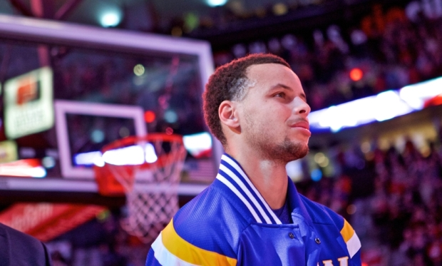 Mar 24, 2015; Portland, OR, USA; Golden State Warriors guard Stephen Curry (30) during national anthem before a game against the Portland Trail Blazers at the Moda Center. Mandatory Credit: Craig Mitchelldyer-USA TODAY Sports