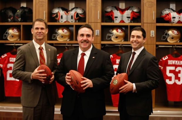 Jan 15, 2015; Santa Clara, CA, USA; San Francisco 49ers general manager Trent Baalke (L), head coach Jim Tomsula (C), and owner Jed York (R) pose for a photo in the locker room after a press conference for the introduction of Tomsula as the head coach at Levi's Stadium Auditorium. Mandatory Credit: Kelley L Cox-USA TODAY Sports