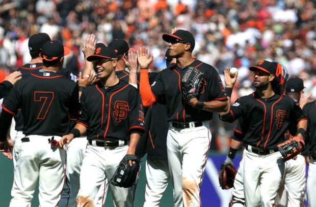 May 2, 2015; San Francisco, CA, USA; San Francisco Giants outfielders left fielder Nori Aoki (23) and right fielder Justin Maxwell (43) and center fielder Angel Pagan (16) celebrate their 5-4 win over the Los Angeles Angels at AT&T Park. Mandatory Credit: Lance Iversen-USA TODAY Sports.