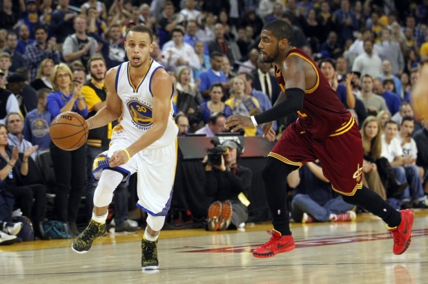 Jan 9, 2015; Oakland, CA, USA; Golden State Warriors guard Stephen Curry (30) dribbles past Cleveland Cavaliers guard Kyrie Irving (2) in the fourth quarter at Oracle Arena. The Warriors defeated the Cavaliers 112-94. Mandatory Credit: Cary Edmondson-USA TODAY Sports