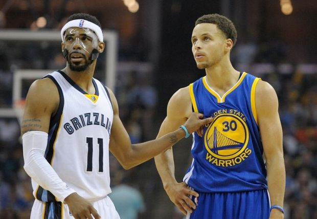 May 9, 2015; Memphis, TN, USA; Memphis Grizzlies guard Mike Conley (11) and Golden State Warriors guard Stephen Curry (30) during game three of the second round of the NBA Playoffs at FedExForum. Memphis Grizzlies beat Golden State Warriors 99-88. Mandatory Credit: Justin Ford-USA TODAY Sports