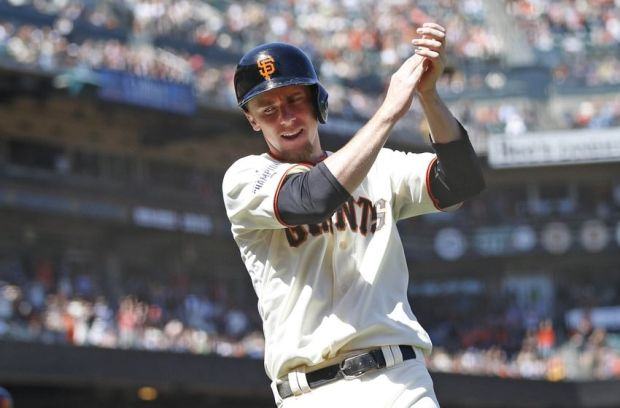 Jun 16, 2015; San Francisco, CA, USA; San Francisco Giants third baseman Matt Duffy (5) celebrates after scoring a run during the eighth inning against the Seattle Mariners at AT&T Park. Mandatory Credit: Bob Stanton-USA TODAY Sports