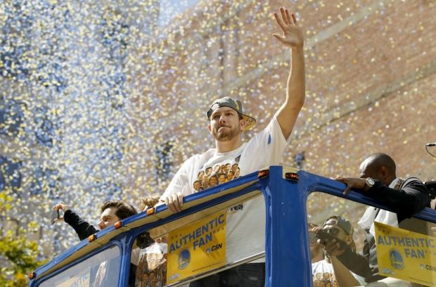 Jun 19, 2015; Oakland, CA, USA; Golden State Warriors forward David Lee waves to the crowd during the Golden State Warriors 2015 championship celebration in downtown Oakland. Mandatory Credit: Cary Edmondson-USA TODAY Sports