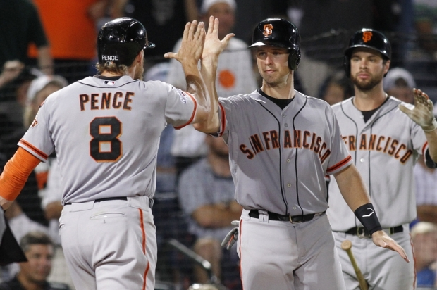 Aug 4, 2015; Atlanta, GA, USA; San Francisco Giants right fielder Hunter Pence (8) celebrates a home run with catcher Buster Posey (28) against the Atlanta Braves in the eighth inning at Turner Field. Mandatory Credit: Brett Davis-USA TODAY Sports