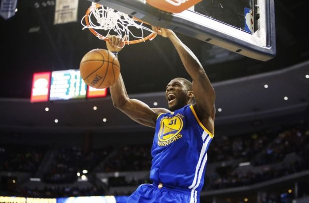 Mar 13, 2015; Denver, CO, USA; Golden State Warriors center Festus Ezeli (31) dunks the ball during the second half against the Denver Nuggets at Pepsi Center. The Nuggets won 114-103. Mandatory Credit: Chris Humphreys-USA TODAY Sports