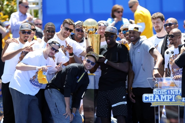 Jun 19, 2015; Oakland, CA, USA; Golden State Warriors hold the trophy during the Golden State Warriors 2015 championship celebration at the Henry J. Kaiser Convention Center. Mandatory Credit: Kelley L Cox-USA TODAY Sports