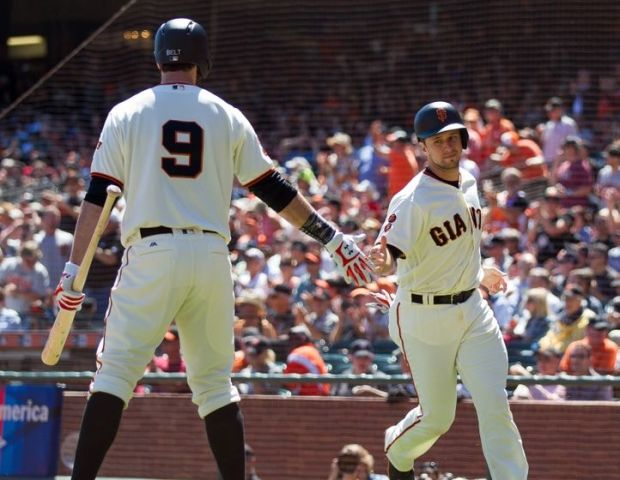Aug 31, 2016; San Francisco, CA, USA; San Francisco Giants catcher Buster Posey (28) is greeted by first baseman Brandon Belt (9) after scoring a run against the Arizona Diamondbacks during the first inning at AT&T Park. Mandatory Credit: Kelley L Cox-USA TODAY Sports